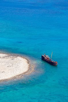 rusty shipwreck working as part of the scenery, Hania, Crete, Greece.  beautiful place :)