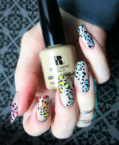 I used 7 different colors to create this free hand rainbow leopard print mani...ALL of them were gel!