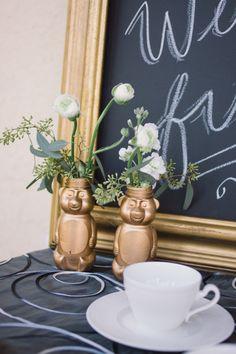 Gold honey bottles as vases