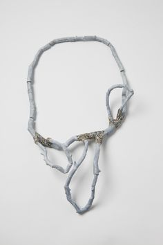 "Carina Shoshtary, ""Confused Branches 1"", necklace, 2015; Wood, graffiti, silver, paint."