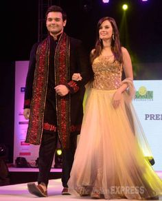 Evelyn Sharma with Mahaakshay Chakraborty on the ramp at the Ramp for Champs fashion show by Smile Foundation.