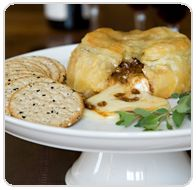 Langenstein's baked brie with praline sauce, perfect party appetizer