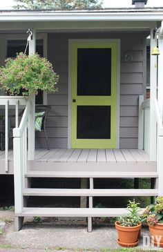 A great way to add some color to your front porch is by building a screen door and painting it a fun bright color. DIY Screen Door.