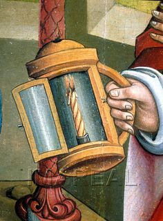 Detail of Joseph holding a lantern that is open to show a twisted candle with…