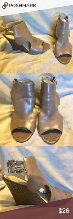 """Ann Taylor taupe Leather peep toe wedge heels 8 Ann Taylor taupe brown leather peep toe wedge heels. Gently used. Size 8 with a 4"""" wedge heel. Ann Taylor Shoes Wedges"""