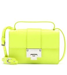 Jimmy Choo Rebel leather shoulder bag-style details Rebel with a cause, Jimmy Choo joins razor-sharp lines with a delectable dash of highlighter yellow colouring. A petite silhouette with a practical shoulder strap, silver-toned hardware and a pebbled leather finish make this one preened addition to pair with both off-duty dresses and night-out numbers. --Check out the hottest fashion trends here: http://www.designerhandbagspurses.net/designer-handbags-are-worth-the-splurge/