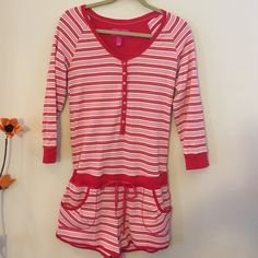 Victorla's Secret Jumper Outfit. Victoria Secret Jumper in red, pink and white stripes. Long sleeves with buttons going down the front. Shorts with pockets. Night or day it's super nice in excellent condition. Victoria's Secret Shorts