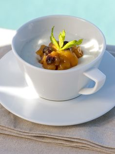 Peach flavored Greek yoghurt with raisins, almonds, and honey at Grace Santorini.