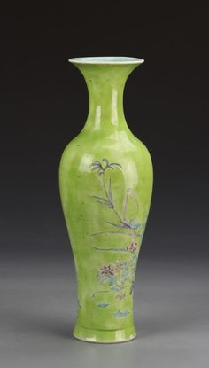 China, 19th C., Famille Rose vase, with a high shoulder sloping into a flared rim, flared base, and plant life motifs against a light green background. Height 12 1/4 in.