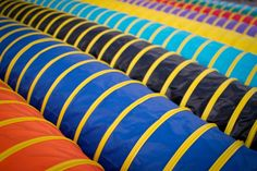 Dog Agility Tunnels, reasonably priced! Colors for sale include: Black, Green, Lt Blue, Orange, Purple, Red, Royal Blue, Teal, Yellow, and Pink