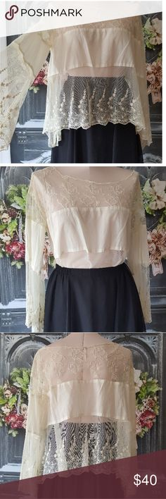 Free people lace boho bell sleeve top small white This is a stunning Free People boho lightweight top with bell lace sleeves and Lace trimming throughout in a size small there's one tiny small Speck on the shirt that is in the 5th picture I'm pointing to it so that you can see it it's a very very light otherwise shirt is in great preowned condition such a gorgeous piece   Pre owned condition *******All items are in pre owned condition, Nothing, unless noted , is brand new **** please ask…