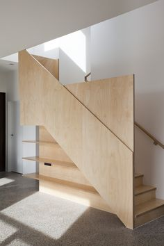 #stairs using geometric facade to create privacy & place for shelves