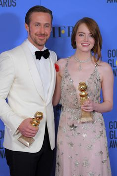 Emma and Ryan posing with their Golden Globe awards for Best Actress and Best Actor in a Musical or Comedy.