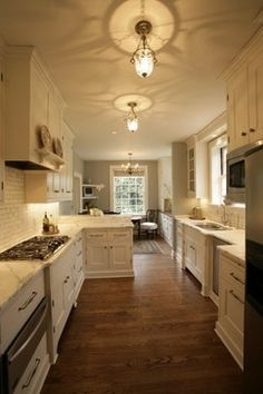 Ideas for odd shaped kitchen with awkward low window for Traditional galley kitchen designs