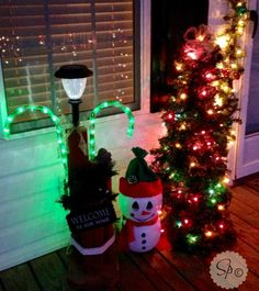 Plastic Pumpkin Snowman and Tomato Cage Christmas Tree