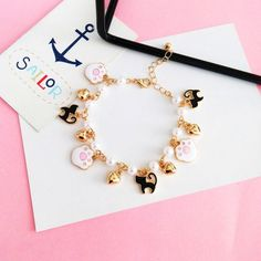Pretty Sakura And Cats Bracelet ●Material: Alloy ●Size: Total cm, cm. time: business days to US, please allow weeks shipping Kawaii Jewelry, Kawaii Accessories, Cute Jewelry, Jewelry Accessories, Fashion Rings, Fashion Jewelry, Backpack For Teens, Accesorios Casual, Gold Earrings Designs