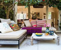 Love the Look ~  Bursts of boho-chic pattern stand out thanks to a muted foundation. In a simple silhouette, with beige or cream cushions, a sleek daybed or chaise longue becomes a blank slate for gorgeously textured pillows and throws.  The low-slung furniture recalls destinations such as Morocco and India, where entertaining is often low to the ground.