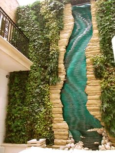 Vertical garden with glass river