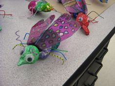 bugs-  model magic bodies  paper clip legs  transparencies with sharpie designs for wings  twisteez for antennas and googley eyes
