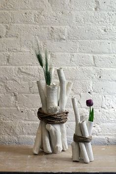 I wonder if each stick is a vase... could make nifty arrangements, if so.