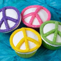 Peace Of Cake Cupcakes - It was a sign of the times in the 60's—now the peace symbol has come full circle for today's parties, with a coating of Wilton Sparkling Sugar in flower-powerful colors.