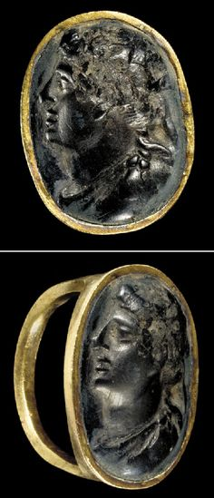 A GREEK GOLD AND BRONZE FINGER RING   HELLENISTIC PERIOD, CIRCA 3RD-2ND CENTURY B.C.   The gold hoop round on the exterior, faceted on the interior, expanding at the shoulders to the broad oval bezel, set with a bronze cameo portrait of a Hellenistic ruler in profile to the left, wearing a fillet in his mass of curly locks, the ties hanging below, with a straight prominent nose and protruding chin, his chlamys pinned to his left shoulder