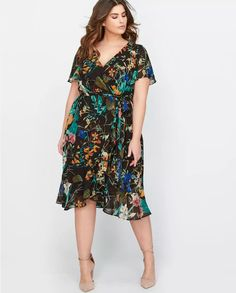 30a403a290 Dark romance—This Michel Studio floral wrap dress can be worn at work or on