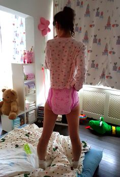 """emma-abdl: """" I'm standing on the bed because I don't feel like nap time :-) See 11 pics of me in my pink PJ's and pink diaper on my cute blog: https://abdlgirl.com/2017/01/22/time-for-naps-and-im-wearing-pink-pjs-and-a-pink-diaper-11-pics/ Xx Emma """""""