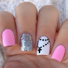 pink, white, and sliver with a black cross on a chain nail art design