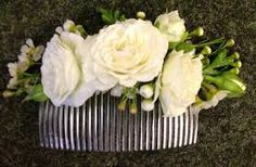 flower hair comb - the flowers get wired onto the comb. We can do fresh or silk flowers.