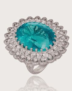 An ocean blue ring featuring a 41.57-carat oval shaped paraíba tourmaline from Mozambique and 8.8-carats of diamonds set in a lace-work of 18k white gold.