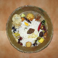 Ritual food, of Newar people of Nepal, placed on plate made by sewing leaves together.
