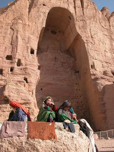 Women and children in front of one of the destroyed Buddhas of Bamiyan, Afghanistan