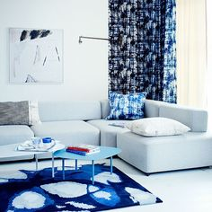 Blue and white painterly living room Go through a blue period and use abstract patterns in a uniform palette of blue for a living room look that's classic rather than crazy. The deep blue-black inky look is tempered by the use of white on walls, floor and furniture, which keeps the scheme fresh, bright and uplifting.