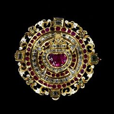A love-token brooch, c.1610-20, made in Prague, has a ruby heart at its centre pierced by diamond arrows, in a symbolic reference to Cupid. (Victoria & Albert Museum)