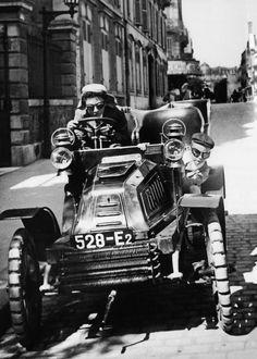 "Jacques-Henri Lartigue, Rue Cortembert, Paris 1903. A ""De Dion-Bouton"" car fitted with puncture-proof ducasble tyres (each element comprises a ball the size of a tennis ball)"