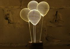 "This simple, minimalist table lamp will make your guests do a double-take. The design etched into the ""bulb"" creating 3D forms on a 2D piece of acrylic. The soft glow and the stunning wire-sculpture that are etched into the lamp makes the Bulbing an intriguing and beautiful addition to any room in your home."