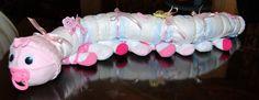 Diaper Caterpillar -- cute alternative to the diaper cake. Instructions at http://www.ehow.com/how_12210382_make-diaper-caterpillar.html