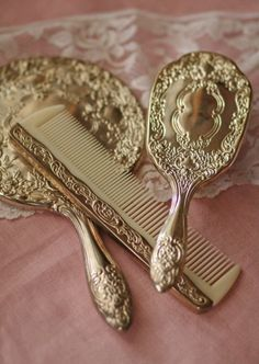 It's a Vintage Life- vanity table set: brush, comb, handheld mirror. Gold, scrolls decoration.