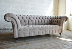 Modern British handmade Naples deep buttoned Chesterfield Sofa, shown in neutral mink velvet. 3 seater | Abode Sofas