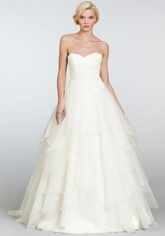 Ivory strapless natural waist bridal ball gown with lace sweetheart neckline bodice and silk organza tiered flouncy skirt with chapel train