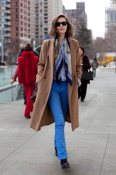 Camel coat, blue pants...and the scarf is such a nice touch