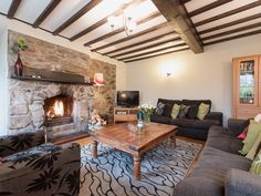 This tastefully decorated Century cottage has been fully restored with cosy open fire. Cosy Lounge, Interior Decorating, Decorating Ideas, Open Fires, 17th Century, Game Room, Cottages, Swimming Pools, Restoration