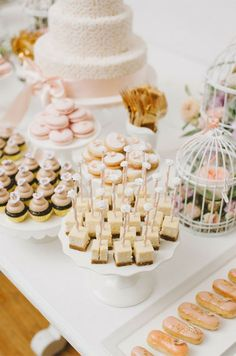 For a feminine feel, try a neutral colored dessert table with soft pink accents.