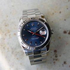 This 2004 Rolex Turn-o-graph Datejust is a beautiful example and in fantastic condition clearly almost never worn. Automatic winding, 31 jewel, sapphire crystal. Stainless steel case with 18ct white gold Thunderbird bezel (36mm diameter). Blue dial with stick markers; red date and second hand. Time keeping is excellent. This is an exemplary piece. The Turn-O-Graph was discontinued in 2011.