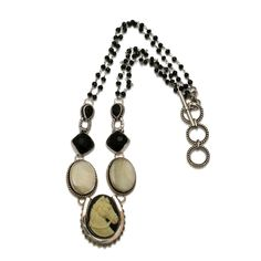 Caracol - Inspired Jewelry and Handbags - Vintage Cameo Horse Necklace by Mars and Valentine, $340.00 (http://www.caracolsilver.com/vintage-cameo-horse-necklace-by-mars-and-valentine/)