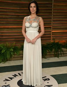 Unusual dress: The actress picked a white Grecian gown with embellished silver straps that cupped her breasts