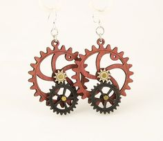 """Made in U.S.A Style # 5001F Size 1.65"""" x 1.5"""" Kinetic Gear Earring 5001F All Gears Move! Comes as shown - Pink/Black Satin/Natural Wood Made from sustainably sourced materials Laser-cut wood Stained with water based dye Ear wires are silver-finished 3041 stainless steel with new electrophoretic-coating that resists tarnishing"""