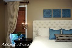 Love the pop of color and how the eye is drawn uup with the three squares above the bed as the accent pillows.
