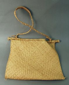 Brazil: Palm-leaf and twill plaited carrying-bag, with shoulder sling. British Museum